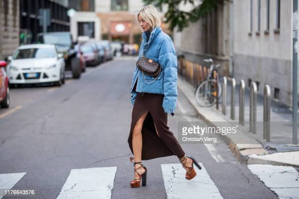 Lisa Hahnbueck is seen wearing blue Unravel down feather jacket in denim, H&M trend dress with slit in brown, Aquazzura heels, Louis Vuitton multi...
