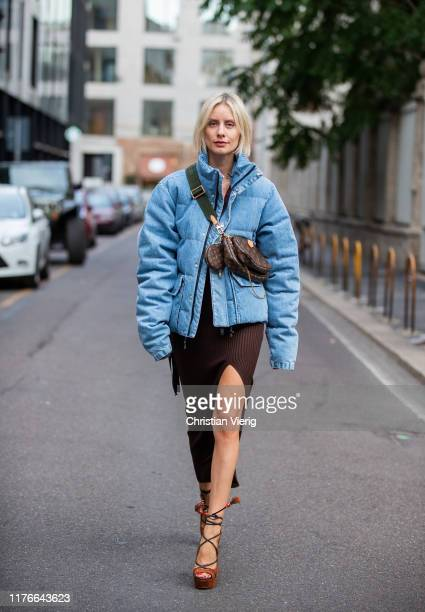 Lisa Hahnbueck is seen wearing blue Unravel down feather jacket in denim HM trend dress with slit in brown Aquazzura heels Louis Vuitton multi...