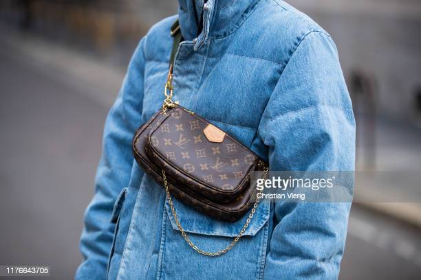 Lisa Hahnbueck is seen wearing blue Unravel down feather jacket in denim Louis Vuitton multi puchette accessoires bag during Milan Fashion Week...