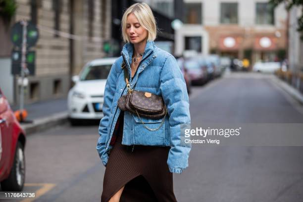 Lisa Hahnbueck is seen wearing blue Unravel down feather jacket in denim HM trend dress with slit in brown Louis Vuitton multi puchette accessoires...