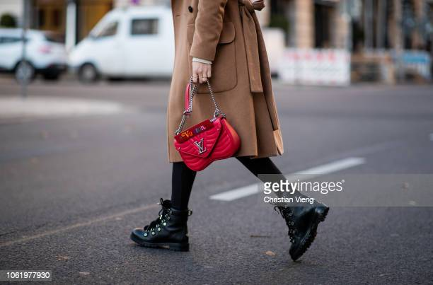 Lisa Hahnbueck is seen wearing brown coat Baum und Pferdgarten Orse und Iris cropped turtleneck red Louis Vuitton New Wave bag Uniqlo x Alexander...