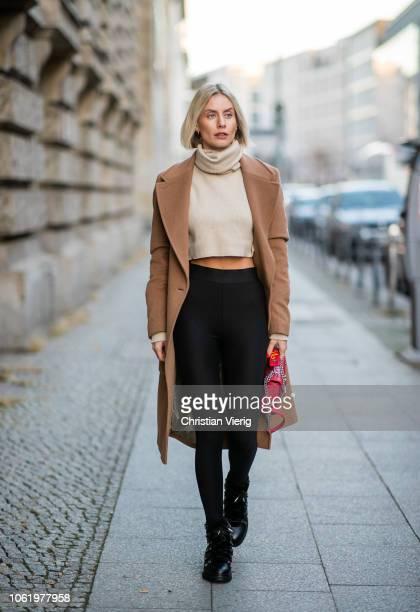Lisa Hahnbueck is seen wearing brown coat Baum und Pferdgarten Orse und Iris cropped turtleneck red Louis Vuitton New Wave bag Uniqlo x Alexander...