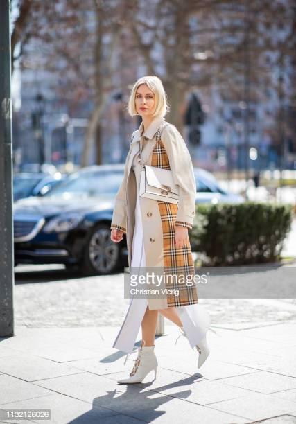 Lisa Hahnbueck is seen wearing Burberry trench coat Sportmax dress Miu Miu shoes Furla bag on Day 5 Milan Fashion Week Autumn/Winter 2019/20 on...