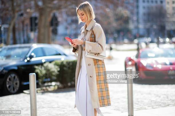 Lisa Hahnbueck is seen wearing Burberry trench coat, Sportmax dress, Furla bag on Day 5 Milan Fashion Week Autumn/Winter 2019/20 on February 24, 2019...