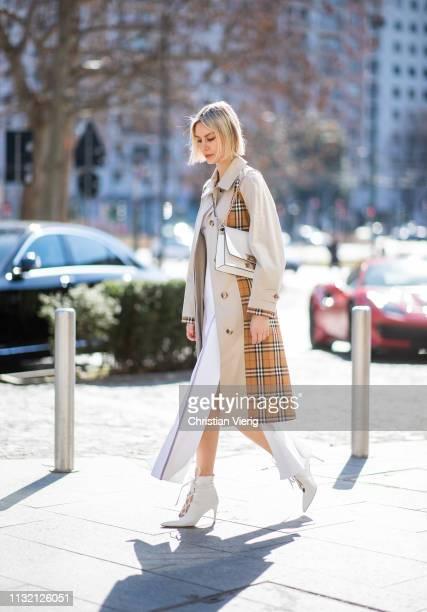 Lisa Hahnbueck is seen wearing Burberry trench coat, Sportmax dress, Miu Miu shoes, Furla bag on Day 5 Milan Fashion Week Autumn/Winter 2019/20 on...
