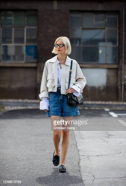 Lisa Hahnbueck is seen wearing cropped beige jeans jacket Baum und Pferdgarten, white blouse Stefanie Giesinger nu-in, shorts Sandro, black loafers...