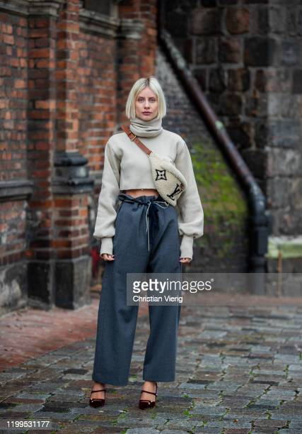 Lisa Hahnbueck is seen wearing cropped turtleneck Orse & Iris, grey paperbag pants Odeeh, Jimmy Choo heels, Louis Vuitton shearling bumbag during the...