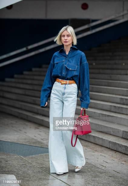 Lisa Hahnbueck is seen wearing denim shirt Odeeh, flared pants Dorothee Schumacher, boots Louis Vuitton, red Hermes 28 Kelly bag, brown belt Hermes...