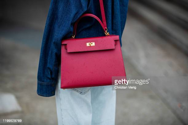 Lisa Hahnbueck is seen wearing denim shirt Odeeh, flared pants Dorothee Schumacher, red Hermes 28 Kelly bag during the Berlin Fashion Week...