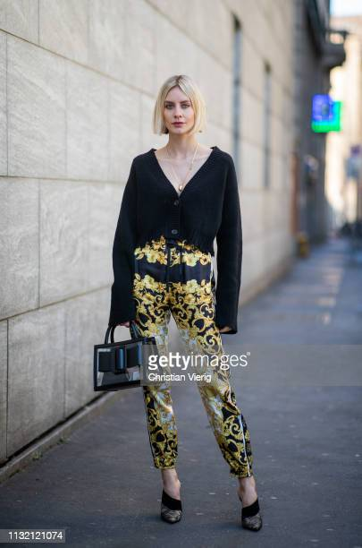 Lisa Hahnbueck is seen wearing Dorothee Schumacher cropped cardigan Versace pants see through Boyy bag shoes wearing on Day 5 Milan Fashion Week...