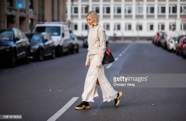 Lisa Hahnbueck is seen wearing Joseph knit, silk dress Mango, sneaker boots Louis Vuitton Cruise 2018, Hermes bag on November 15, 2018 in Berlin,...
