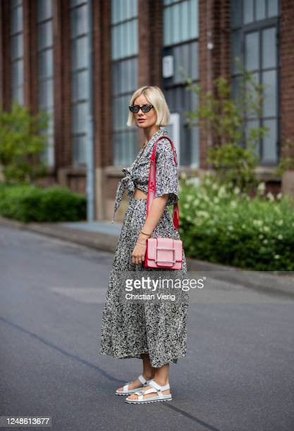 Lisa Hahnbueck is seen wearing Les Coyotes de Paris dress with print, Roger Vivier red bag and white trekking sandals, Gucci sunglasses on June 09,...