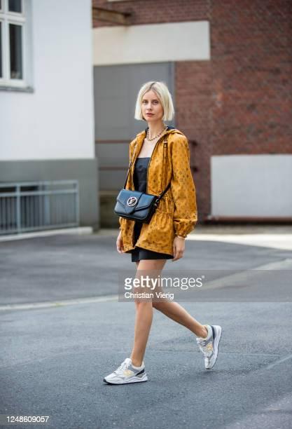 Lisa Hahnbueck is seen wearing Louis Vuitton leather parka with logo print, black Realisation Par dress, Louis Vuitton Pont Neuf bag, New Balance...