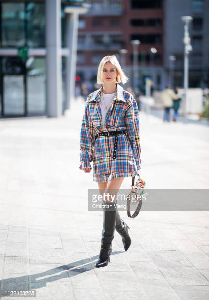 Lisa Hahnbueck is seen wearing Marques Almeida button shirt and skirt Fendi bag Jimmy Choo Mavis boots on Day 5 Milan Fashion Week Autumn/Winter...