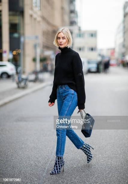 Lisa Hahnbueck is seen wearing navy Louis Vuitton turtleneck cropped navy blue Re/Done denim jeans Jimmy Choo x My Theresa plaid boots velvet Chanel...