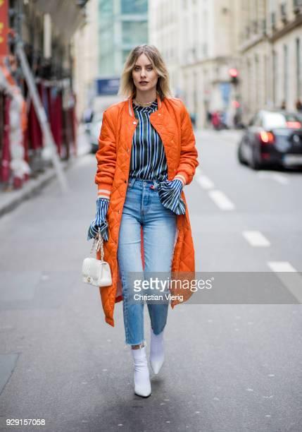 Lisa Hahnbueck is seen wearing orange puffer jacket Baum und Pferdgarten coat cropped Levis jeans striped blouse Maggie Marylin Jimmy Chooe white...
