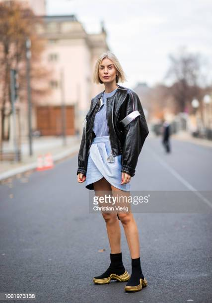 Lisa Hahnbueck is seen wearing oversized leather jacket with belt application baby blue asymmetric skirt and top and socks boots all Louis Vuitton...