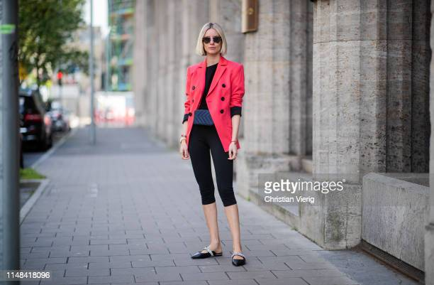 Lisa Hahnbueck is seen wearing red Dorothee Schumacher blazer 3/4 leggings Celine shirt shoes Kurt Geiger Sandro belt bag on May 05 2019 in...