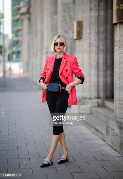 Lisa Hahnbueck is seen wearing red Dorothee Schumacher blazer, 3/4 leggings, Celine shirt, shoes Kurt Geiger, Sandro belt bag on May 05, 2019 in...