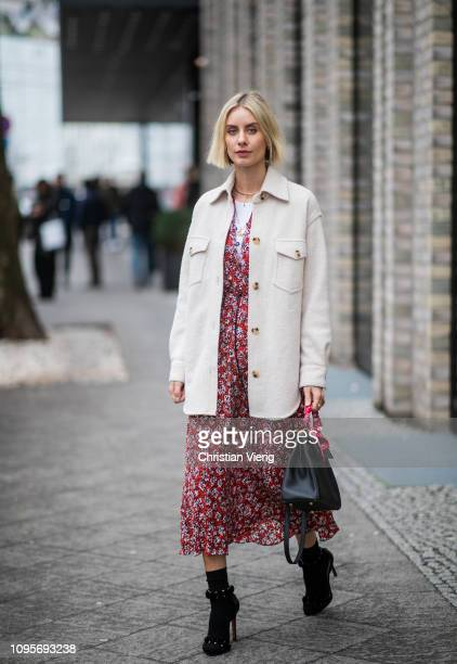 Lisa Hahnbueck is seen wearing red dress with floral print black Hermes bag white jacket black heels during the Berlin Fashion Week Autumn/Winter...