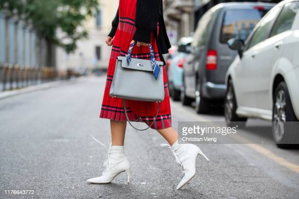 Lisa Hahnbueck is seen wearing red striped Marni pencil skirt, black Dorothee Schumacher knit, white laced Miu Miu heels, Kelly Hermes bag during...