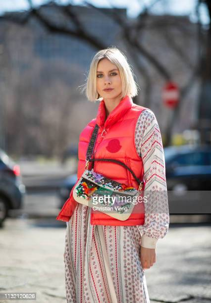 Lisa Hahnbueck is seen wearing red vest Moncler Philosophy maxi dress Fendi bag on Day 5 Milan Fashion Week Autumn/Winter 2019/20 on February 24 2019...
