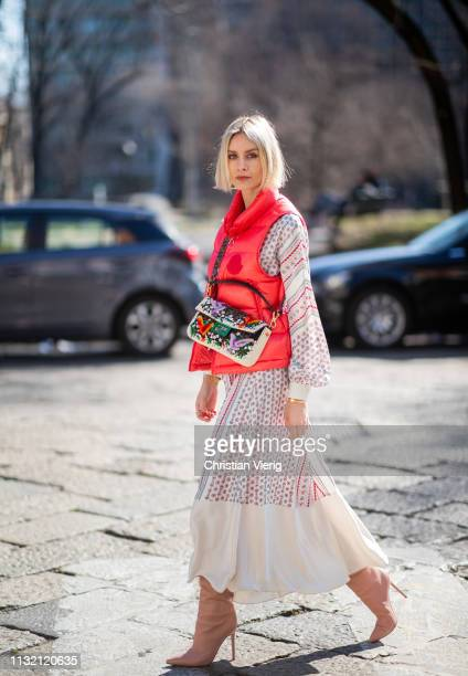 Lisa Hahnbueck is seen wearing red vest Moncler Philosophy maxi dress Gianvitto Rossi boots Fendi bag on Day 5 Milan Fashion Week Autumn/Winter...