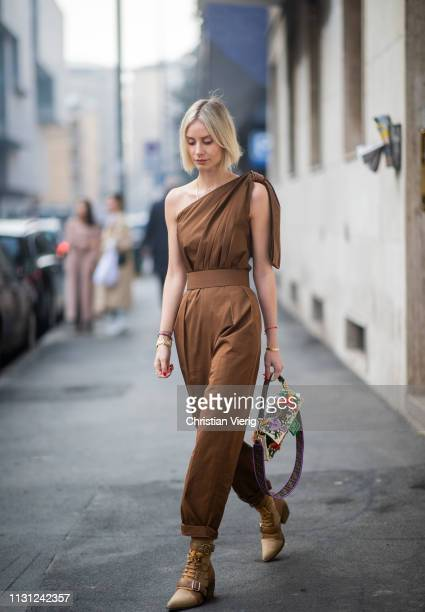 Lisa Hahnbueck is seen wearing ripped off brown overall Fendi bag with floral print outside Max Mara on Day 2 Milan Fashion Week Autumn/Winter...