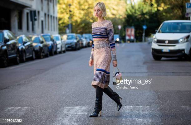 Lisa Hahnbueck is seen wearing See by Chloe skirt and knit set, Jimmy Choo Mavis boots, Manu Atelier bag during Milan Fashion Week Spring/Summer 2020...
