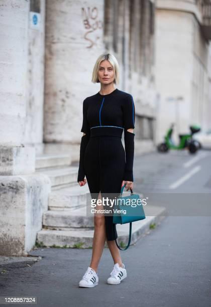 Lisa Hahnbueck is seen wearing Victoria Beckham knitted dress, Adidas superstar sneaker, Hermes Kelly bag 25 during Milan Fashion Week Fall/Winter...