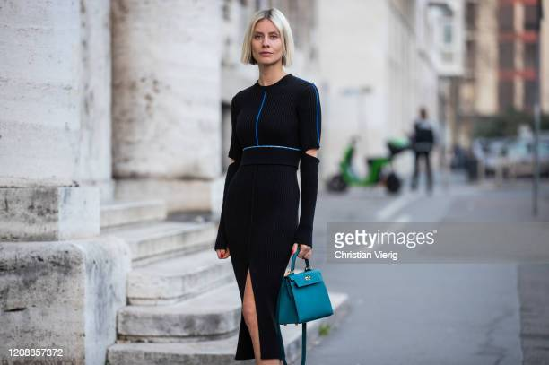 Lisa Hahnbueck is seen wearing Victoria Beckham knitted dress, Hermes Kelly bag 25 during Milan Fashion Week Fall/Winter 2020-2021 on February 22,...