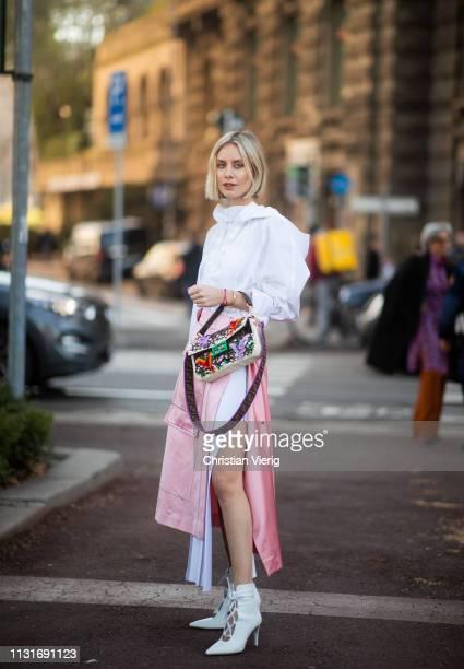 Lisa Hahnbueck is seen wearing white dress pink skirt slit Fendi bag outside Sportmax on Day 3 Milan Fashion Week Autumn/Winter 2019/20 on February...