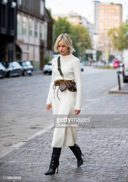 Lisa Hahnbueck is seen wearing white Maje knit and skirt, Jimmy Choo Mavis boots, Louis Vuitton mulit pouchette accessoires during Milan Fashion Week...