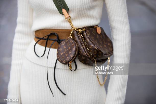 Lisa Hahnbueck is seen wearing white Maje knit and skirt, Louis Vuitton mulit pouchette accessoires during Milan Fashion Week Spring/Summer 2020 on...