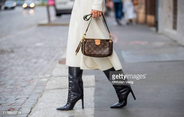 Lisa Hahnbueck is seen wearing white Maje skirt Jimmy Choo Mavis boots Louis Vuitton mulit pouchette accessoires during Milan Fashion Week...