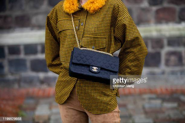 Lisa Hahnbueck is seen wearing yellow checkered button shirt Odeeh wild leather pants Set black Chanel bag during the Berlin Fashion Week...
