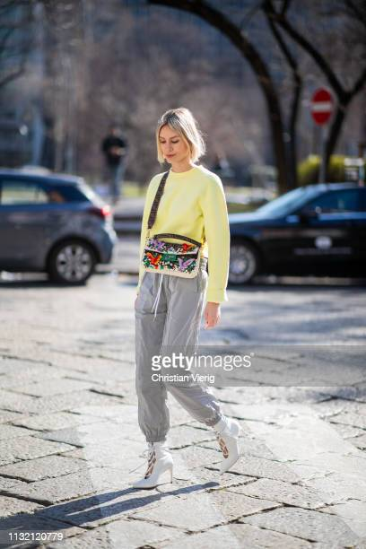 Lisa Hahnbueck is seen wearing yellow neon T By Alexander Wang jumper and grey track suit pants white Miu Miu shoes Fendi bag on Day 5 Milan Fashion...