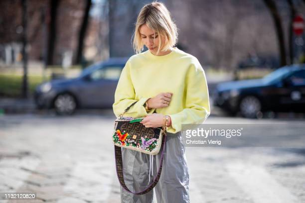 Lisa Hahnbueck is seen wearing yellow neon T By Alexander Wang jumper and grey track suit pants Fendi bag on Day 5 Milan Fashion Week Autumn/Winter...