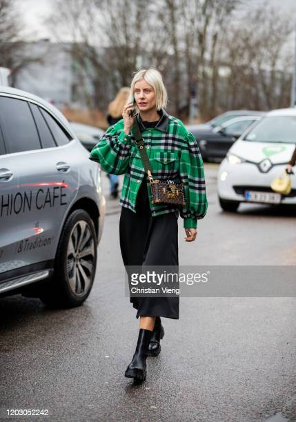 Lisa Hahnbueck seen wearing green checkered jacket, Louis Vuitton bag, black dress seen outside Rodebjer during Copenhagen Fashion Week Autumn/Winter...