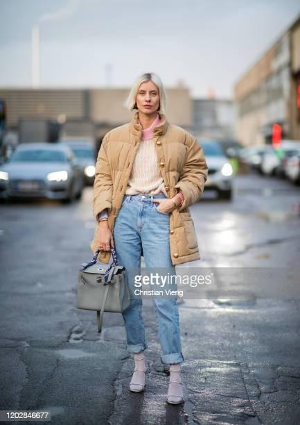 Lisa Hahnbueck seen wearing vintage Burberry down jacket, Stine Goya knit, agolde boyfriend jeans, amina muaddi heels, hermes bag outside Stine Goya...