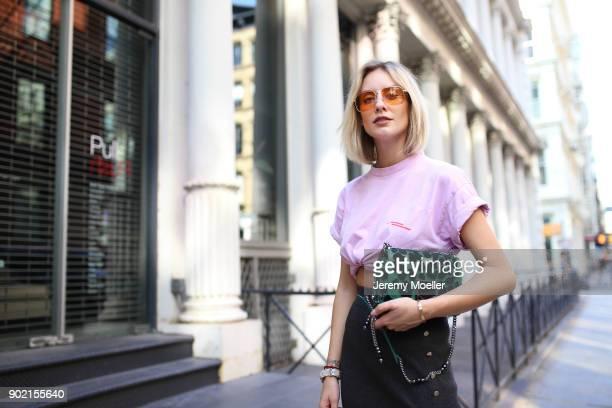 Lisa Hahnbueck wearing a Ariane Ernst Tshirt, Zara Skirt, Jimmy Choo Lockett Bag, Vogue Eyewear x Gigi Hadid Sunglasses on September 04, 2017 in New...