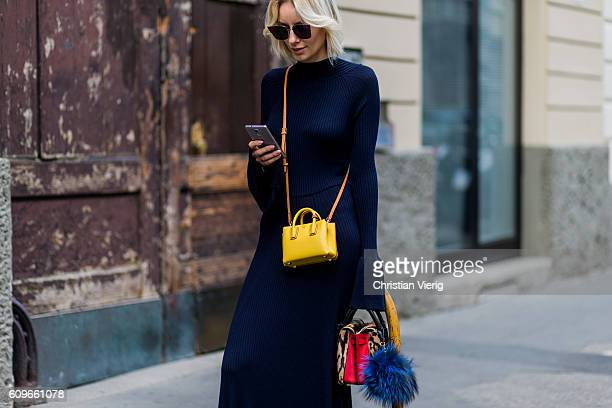 Lisa Hahnbueck wearing a backless Knitdress with big sleeves HM Trend Milla Gepard Tote Mini Milla Micro Bag / XMini Fendi sunglasses is seen outside...