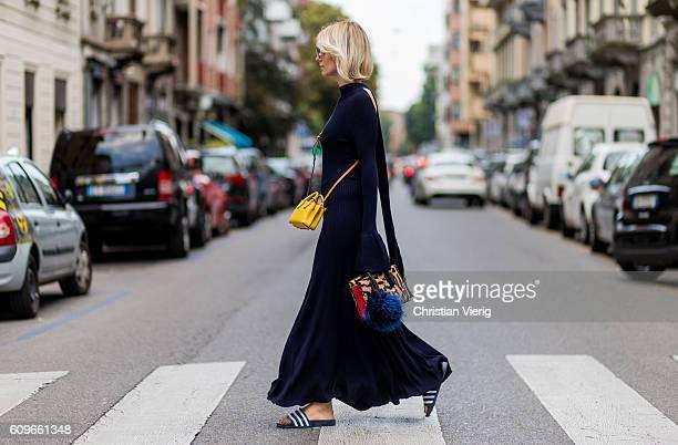 Lisa Hahnbueck wearing a backless Knitdress with big sleeves HM Trend Milla Gepard Tote Mini Milla Micro Bag / XMini adiletten Fendi sunglasses is...