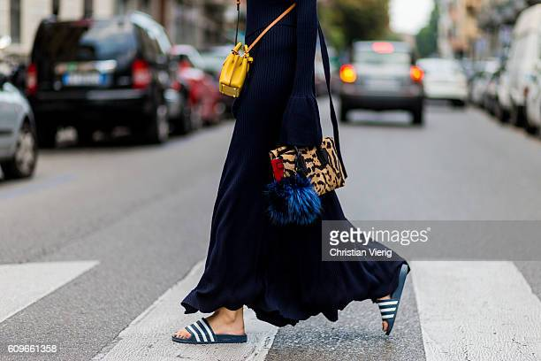 Lisa Hahnbueck wearing a backless Knitdress with big sleeves HM Trend Milla Gepard Tote Mini Milla Micro Bag / XMini adiletten is seen outside...