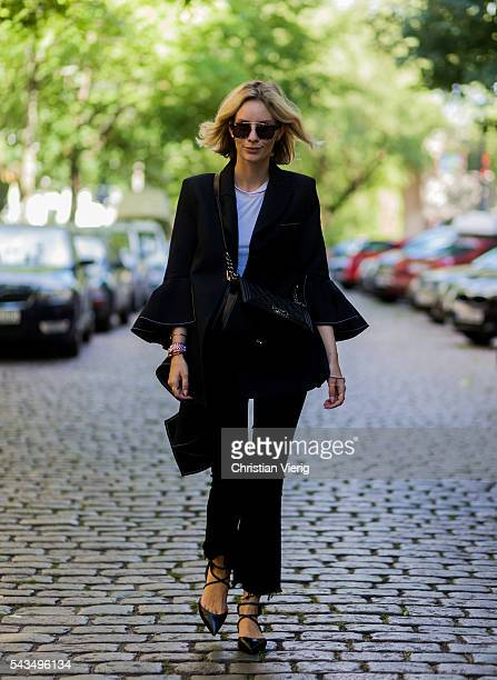 Lisa Hahnbueck wearing a black blazer from Ellery J Brand jeans Chanel bag and Christian Louboutin laced flats during the MercedesBenz Fashion Week...
