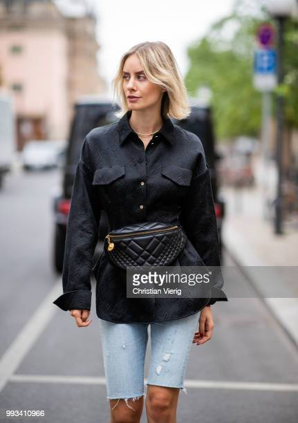 Lisa Hahnbueck wearing a black Dorothee Schumacher button shirt Versace fanny belt bag cropped denim jeans Levis Gucci shoes seen during the Berlin...