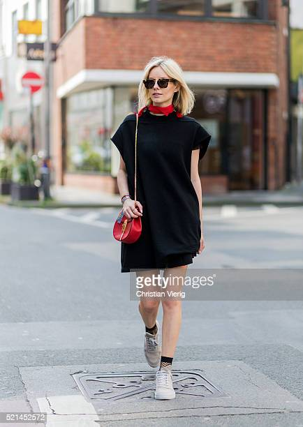 Lisa Hahnbueck wearing a black oversized hoody from Rick Owens a black dress from Maje a red Chloe bag white sneaker from Filling Pieces and a red...