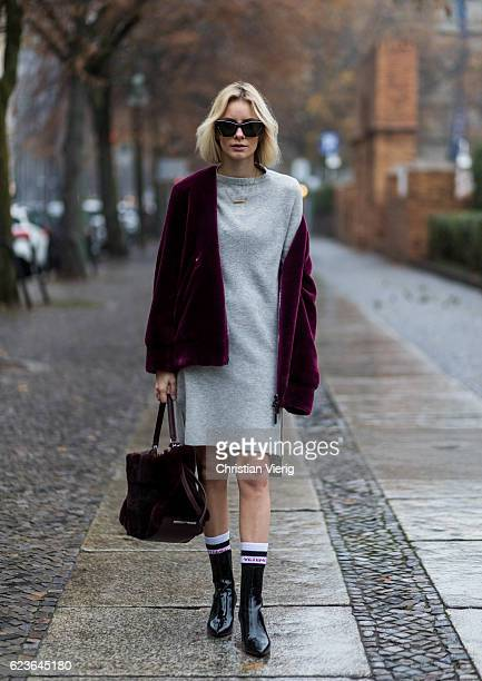 Lisa Hahnbueck wearing a bordeaux Aigner Faux Fur Bomber Jacket a grey Duffy Cashmere Knit Aeyde Patent Leather Naplak Ankle Boots Aigner Carla Bag...