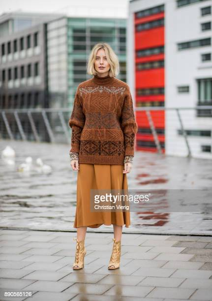 Lisa Hahnbueck wearing a brown knit Mulberry a brown Rochas dress golden Gianvito Rossi high heels on December 11 2017 in Duesseldorf Germany