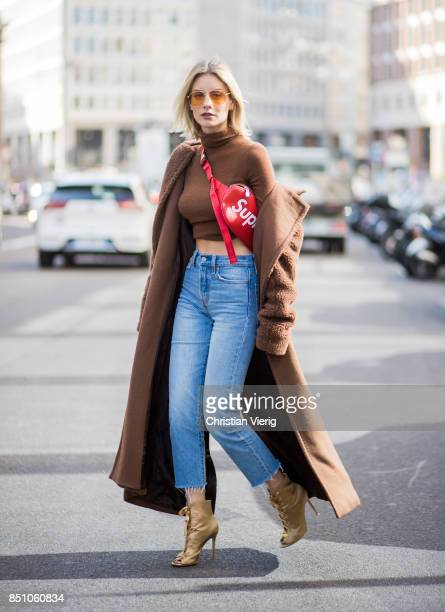 Lisa Hahnbueck wearing a brown Max Mara coat Max Mara turtleneck Levis wedgie jeans Gianvito Rossi heels Supreme x Louis Vuitton belt bag Vogue...